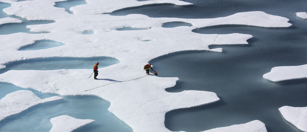 The crew of the  U.S. Coast Guard Cutter Healy, in the midst of their ICESCAPE mission, retrieves supplies for some mid-mission fixes dropped by parachute from a C-130 in the Arctic Ocean in this July 12, 2011 NASA handout photo obtained by Reuters June 11, 2011. Scientists punched through the sea ice to find waters richer in phytoplankton than any other region on earth.  Phytoplankton, the base component of the marine food chain, were thought to grow in the Arctic Ocean only after sea ice had retreated for the summer. Scientists now think that the thinning Arctic ice is allowing sunlight to reach the waters under the sea ice, catalyzing the plant blooms where they had never been observed. REUTERS/Kathryn Hansen/NASA   (UNITED STATES - Tags: ENVIRONMENT SCIENCE TECHNOLOGY) THIS IMAGE HAS BEEN SUPPLIED BY A THIRD PARTY. IT IS DISTRIBUTED, EXACTLY AS RECEIVED BY REUTERS, AS A SERVICE TO CLIENTS. FOR EDITORIAL USE ONLY. NOT FOR SALE FOR MARKETING OR ADVERTISING CAMPAIGNS - TM3E86B0WCN01