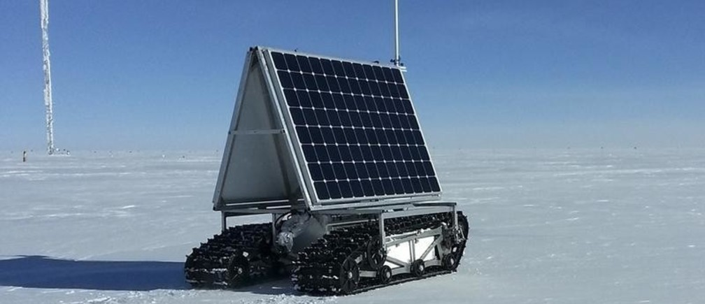 NASA's new Earth-bound rover, GROVER, which stands for both Greenland Rover and Goddard Remotely Operated Vehicle for Exploration and Research, in Summit Camp, the highest spot in Greenland, is shown in this May 10, 2013 release. GROVER is an autonomous, solar-operated robot that carries a ground-penetrating radar to examine the layers of Greenland's ice sheet. Its findings will help scientists understand how the massive ice sheet gains and loses ice. After loading and testing the rover's radar and fixing a minor communications glitch, the team began the robot's tests on the ice on May 8, defying winds of up to 23 mph (37 kph) and temperatures as low as minus 22 F (minus 30 C).The GROVER tests will continue through June 8.  Lora Koenig /NASA Goddard/Handout via Reuters  (GREENLAND - Tags: ENVIRONMENT SCIENCE TECHNOLOGY) FOR EDITORIAL USE ONLY. NOT FOR SALE FOR MARKETING OR ADVERTISING CAMPAIGNS. THIS IMAGE HAS BEEN SUPPLIED BY A THIRD PARTY. IT IS DISTRIBUTED, EXACTLY AS RECEIVED BY REUTERS, AS A SERVICE TO CLIENTS - GM1E95B0BMS01