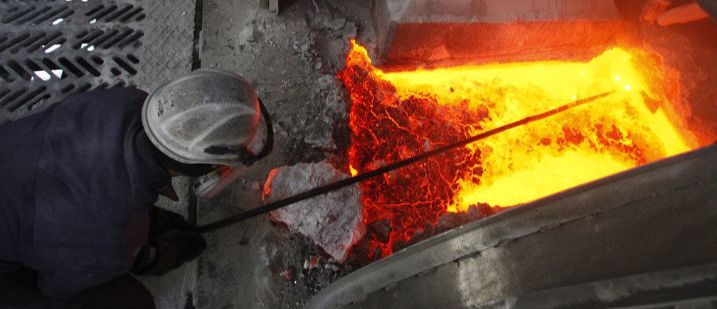 A worker operates an electrolysis furnace, which produces aluminium from raw materials, at the electrolysis shop of the Rusal Krasnoyarsk aluminium smelter plant in the Siberian city of Krasnoyarsk February 3, 2010. The plant is one of the biggest aluminium plants in Russia