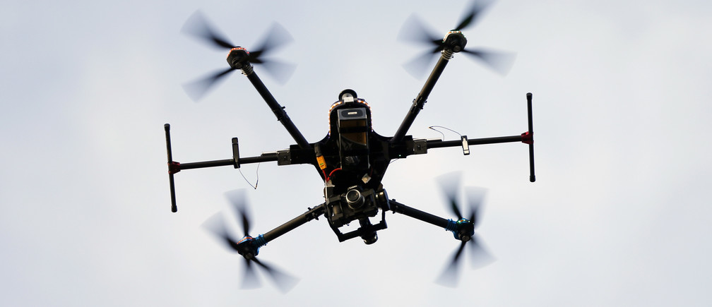 A Belgian Federal Police drone takes off from the airfield in Brasschaat near Antwerp, Belgium, December 23, 2015. The first drone to be used by Belgian federal police can fly with 135 km/h, up to 2km high and will be deployed to watch over crime scenes, respond to threats, and look for missing people, according to Belgian Federal Police