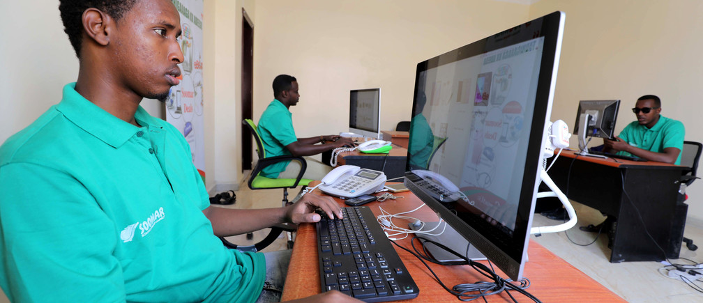 Employees at the Somali Online Market (SOOMAR) work inside their office in the Hodan district of Mogadishu, Somalia, October 17, 2018 REUTERS/Feisal Omar - RC1586162970