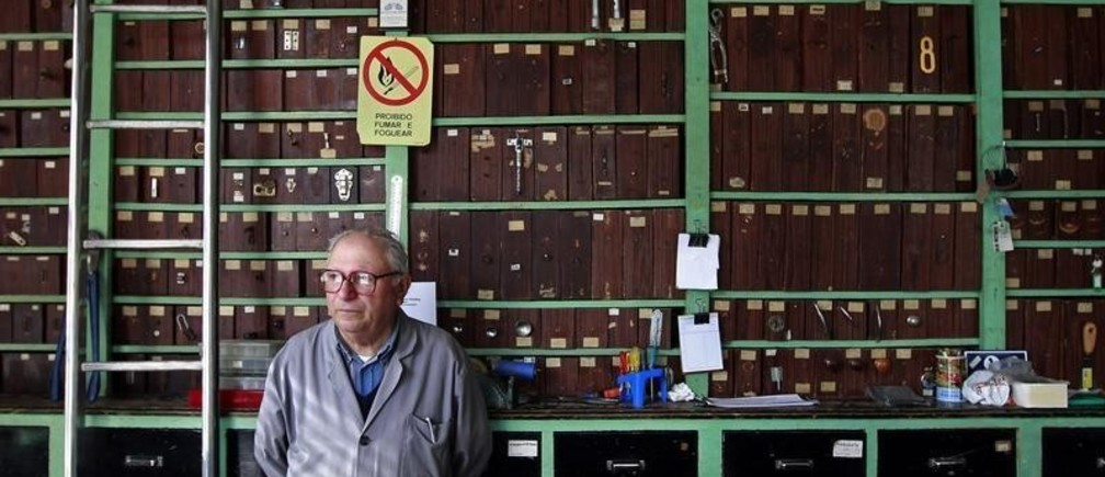 Francisco Santos waits for clients at his ironmonger shop in Sintra May 25, 2011. Santos is now selling the last of his last products before shutting down his business after firing his four employees. Finland's parliament approved Portugal's bailout package on Wednesday, with critics such as the populist True Finns party outnumbered by supporters of the 78 billion euro ($110 billion) plan by the European Union and IMF. REUTERS/Jose Manuel Ribeiro (PORTUGAL - Tags: POLITICS BUSINESS EMPLOYMENT) - GM1E75P1NHE01
