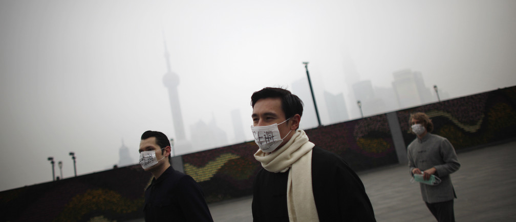 "A group of expatriates walk along the Bund as they distribute face masks to pedestrians to raise awareness of air pollution in downtown Shanghai January 24, 2013. According to the U.S. consulate air quality readings, which measure PM2.5 particulates Shanghai's air quality was ""very unhealthy"" on Thursday. REUTERS/Carlos Barria"