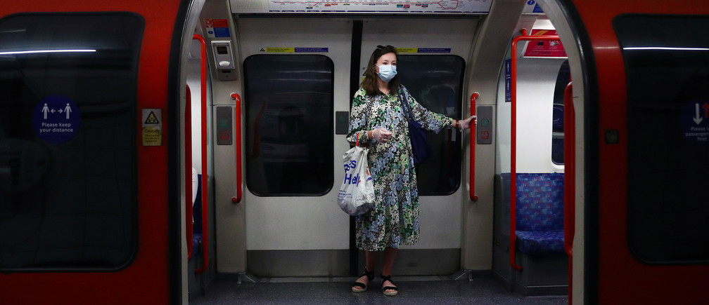 A passenger wearing a face mask travels on the Central Line tube, amid the spread of the coronavirus disease (COVID-19) in London, Britain June 15, 2020. REUTERS/Hannah McKay - RC2M9H9RHUXI