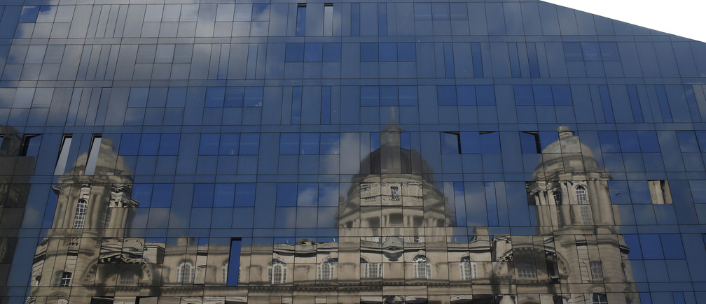 The Port of Liverpool building is seen reflected in the windows of a modern office block in Liverpool northern Britain, September 16 , 2015.  The Port of Liverpool building was built in 1907 and is the former home of the Mersey Docks and Harbour Board. REUTERS/Phil Noble    - LR2EB9G12UFD7