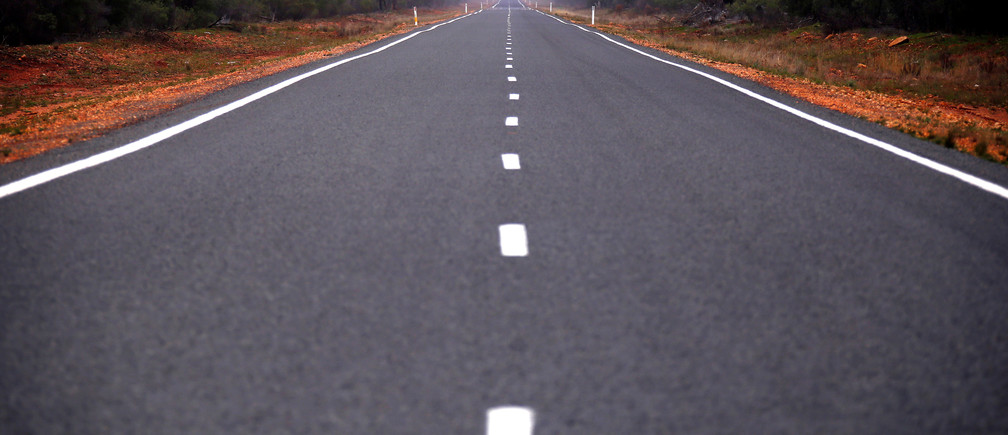 """A bitumen road is seen near the western New South Wales outback town of Bourke, Australia, June 23, 2016.    REUTERS/David Gray SEARCH """"VOTE OUTBACK"""" FOR THIS STORY. SEARCH """"THE WIDER IMAGE"""" FOR ALL STORIES. - S1AETMTVNTAA"""