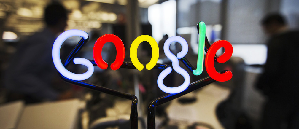 A neon Google logo is seen at the new Google office in Toronto, November 13, 2012.    REUTERS/Mark Blinch (CANADA - Tags: SCIENCE TECHNOLOGY BUSINESS LOGO) - RTR3ACWW