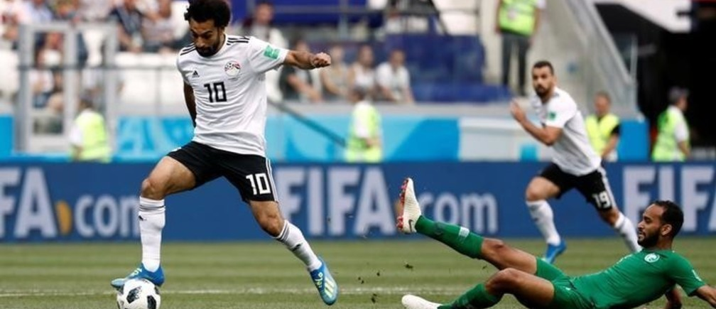 Soccer Football - World Cup - Group A - Saudi Arabia vs Egypt - Volgograd Arena, Volgograd, Russia - June 25, 2018   Egypt's Mohamed Salah in action with Saudi Arabia's Abdullah Otayf      REUTERS/Damir Sagolj