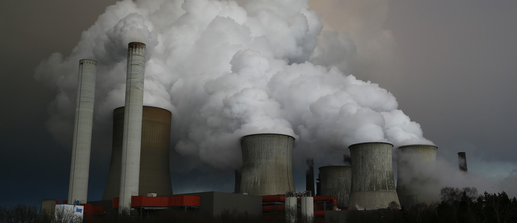 Steam rises from the cooling towers of the coal power plant of RWE, one of Europe's biggest electricity and gas companies in Niederaussem, north-west of Cologne, Germany.