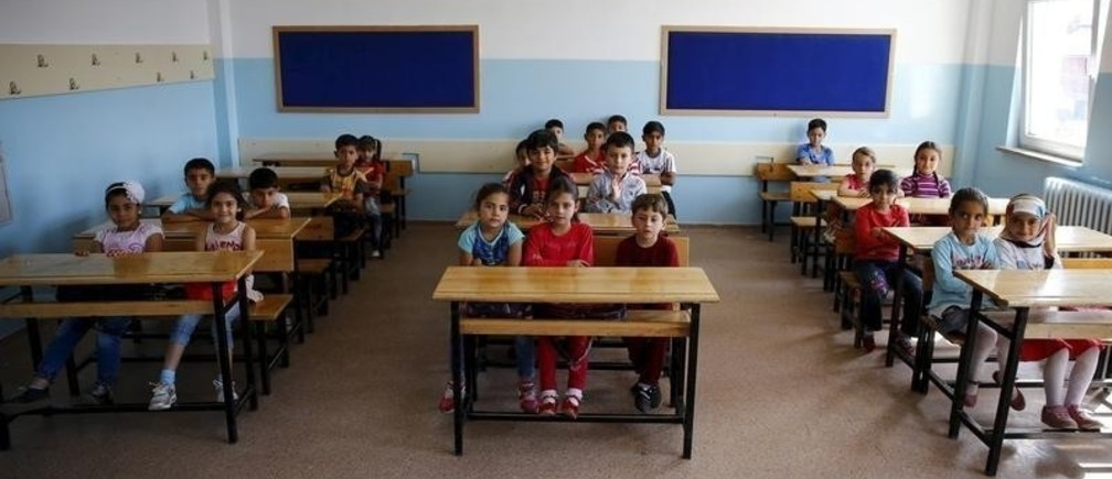 Syrian refugee students in second grade wait for the start of their first lesson of the year at Fatih Sultan Mehmet Primary School in Ankara, Turkey, September 28, 2015.