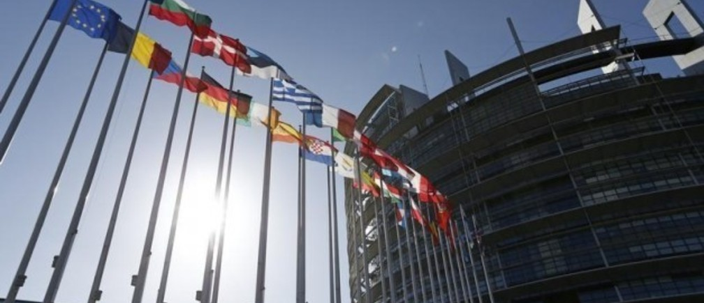 Flags of European Union member states fly in front of the European Parliament building in Strasbourg, April 15, 2014. REUTERS/Vincent Kessler