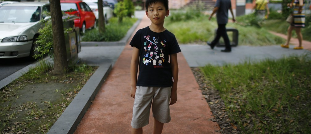 """Yu Yan, who was born in 2004, poses for a photograph in Shanghai August 24, 2014.  """"I want to have someone to play with,"""" said Yan. Reuters Photographer Carlos Barria photographed a person born in each year China?s one child policy has been in existence; from a man born in 1979, to a baby born in 2014, and asked them if they would have like to have siblings. China, the world's most populous country with nearly 1.4 billion people, says the country's one-child policy has averted 400 million births since 1980, saving scarce food resources and helping to pull families out of poverty. Couples violating the policy have had to pay a fine, or in some cases have been forced to undergo abortions.  But late last year, China said it would allow millions of families to have two children, part of a plan to raise fertility rates and ease the financial burden on a rapidly ageing population. Picture taken August 24, 2014. REUTERS/Carlos Barria  (CHINA - Tags: SOCIETY POLITICS PORTRAIT) ATTENTION EDITORS - PICTURE 12 OF 37 FOR WIDER IMAGE STORY '36 YEARS OF CHINA'S ONE CHILD POLICY'SEARCH 'BARRIA CHILD' FOR ALL PICTURES - RTR491R0"""
