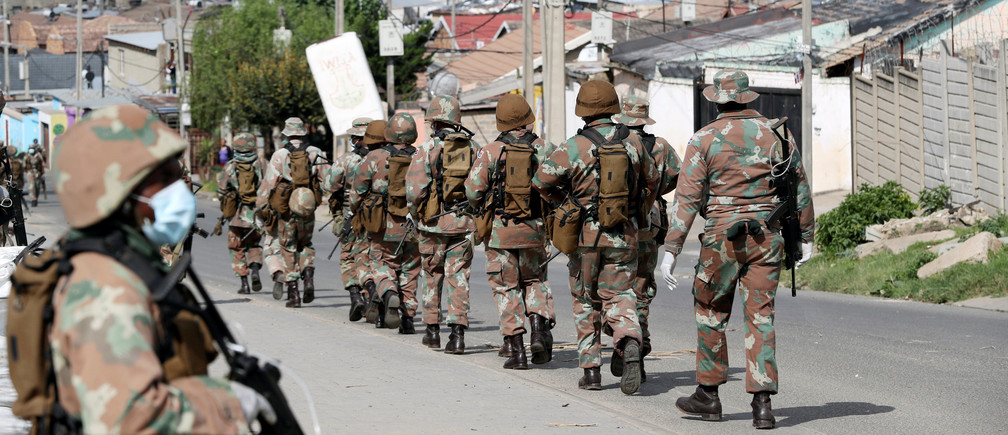 Soldiers patrol the streets in Alexandra township, Johannesburg, South Africa.
