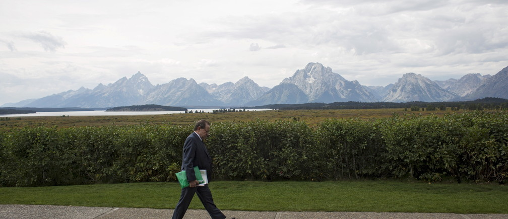 European Central Bank Vice President Vitor Constancio walks in front of the Teton Range during the Federal Reserve Bank of Kansas City's annual Jackson Hole Economic Policy Symposium in Jackson Hole