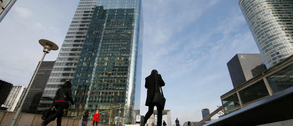 A businessman walks at La Defense business and financial district in Courbevoie near Paris.