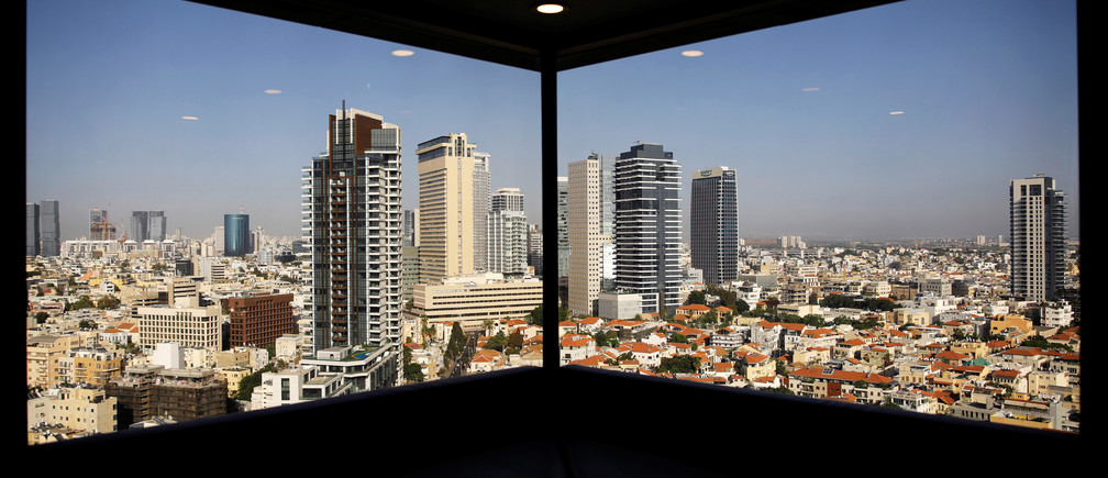 A general view of Tel Aviv's skyline is seen through a hotel window in Tel Aviv, Israel May 15, 2017. Picture taken May 15, 2017