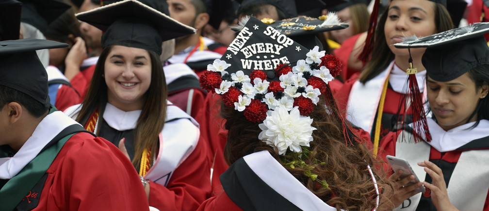 """A 2016 graduate of Rutgers University wears a mortar board with the slogan """"Next Stop Everywhere,"""" suggesting unbound optimism after years of a heavy school workload"""