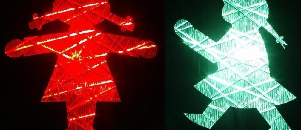 A combination of two pictures shows a pedestrian red and green crossing signal featuring a woman in Zwickau.  A combination of two pictures shows a pedestrian red and green crossing signal featuring a woman in the east German town of Zwickau, about 250 kilometres south east of Berlin November 27, 2004. Some of the pedestrian crossings traffic lights in Zwickau have been seized by the equality of the sexes, with little green women replacing little green men from this week. REUTERS/Fabrizio Bensch - RP5DRHYHIZAC
