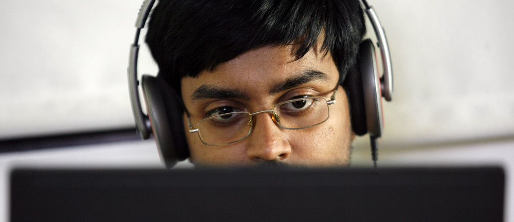 A researcher works on his laptop at the Microsoft India research centre in Bangalore June 24, 2009. Staffed with about 60 full-time researchers, many of them Indians with PhDs from top universities in the United States, the centre is at the cutting edge of Microsoft's R&D. It covers seven areas of research including mobility and cryptography. Its success, including developing a popular tool for Microsoft's new search engine Bing, underscores the potential of R&D in India at a time when cost-conscious firms are keen to offshore to save money by using talented researchers abroad.   To match feature INDIA-R&D/ REUTERS/Punit Paranjpe (INDIA SCI TECH BUSINESS) - GM1E57L0LK401