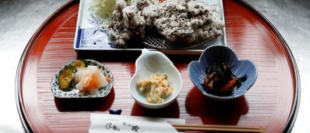 A set menu of deep-fried whale nuggets are prepared at the restaurant P-man in Minamiboso, east of Tokyo, Japan June 14, 2019. Picture taken June 14, 2019.  REUTERS/Issei Kato - RC1E0BAC9A40
