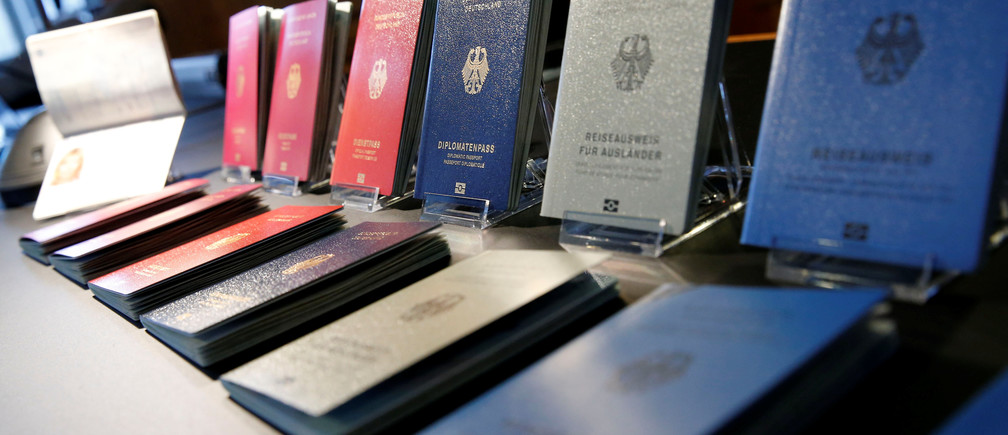 Specimens of the German new electronic passports are pictured during a presentation to the media in Berlin, Germany, February 23, 2017.     REUTERS/Fabrizio Bensch - RC1E84DD6AB0