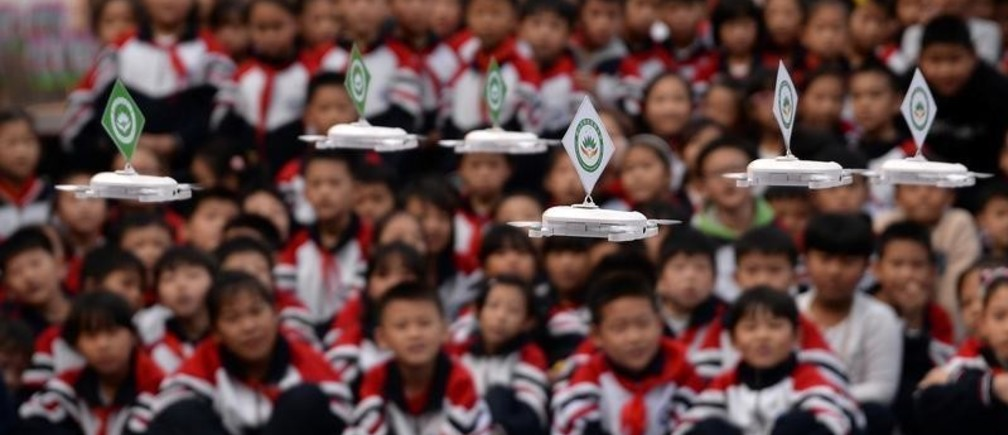 Students watch a drone performance at a primary school in Handan, Hebei province, China October 18, 2018. Picture taken October 18, 2018.