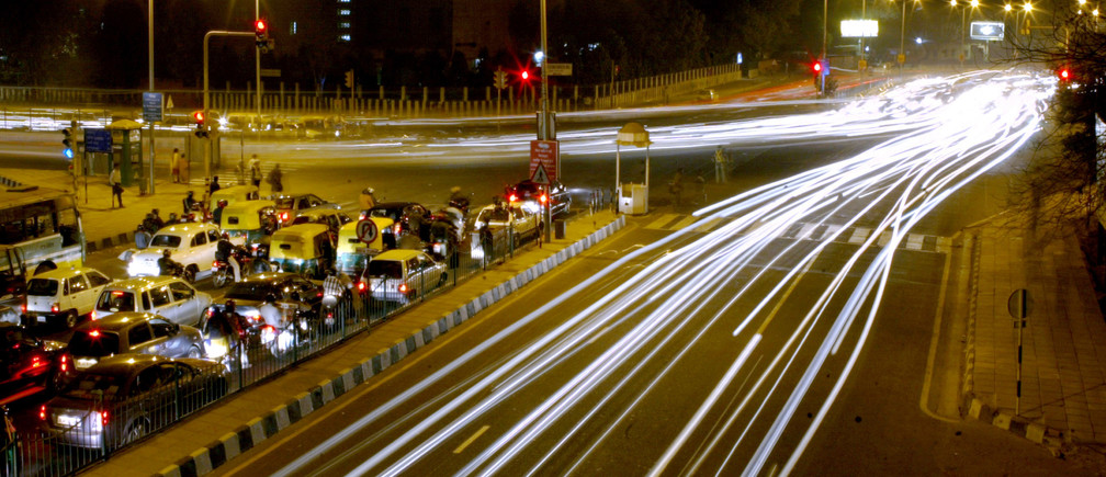 Vehicular traffic moves on a street in New Delhi in this February 7, 2006 file photo. REUTERS/Kamal Kishore