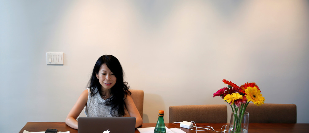 """Venture capitalist Eva Ho, 44, who runs a seed fund, works on her computer in Los Angeles, California, United States, June 21, 2016. """"In some ways the VC career has really been an old boys club and it's been dominated by white men for the last three or four decades,"""" Ho said. """"I wish gender wasn't an issue, and I'm hoping that with Hillary gender will no longer be an issue. I think girls and boys need examples of leadership that are represented by women."""" Picture taken June 21, 2016. REUTERS/Lucy Nicholson          SEARCH """"WOMEN WORKERS"""" FOR THIS STORY. SEARCH """"THE WIDER IMAGE"""" FOR ALL STORIES      - RTSJBNU"""