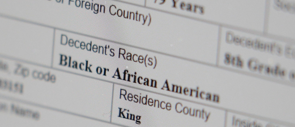 """A working copy of a death certificate for a man who died of coronavirus disease (COVID-19) indicates that the man's race was """"Black or African American,"""" as seen on a computer screen at the Dayspring & Fitch Funeral Home offices, in Seattle, Washington, U.S. April 7, 2020.  REUTERS/David Ryder - RC200G92LWBF"""