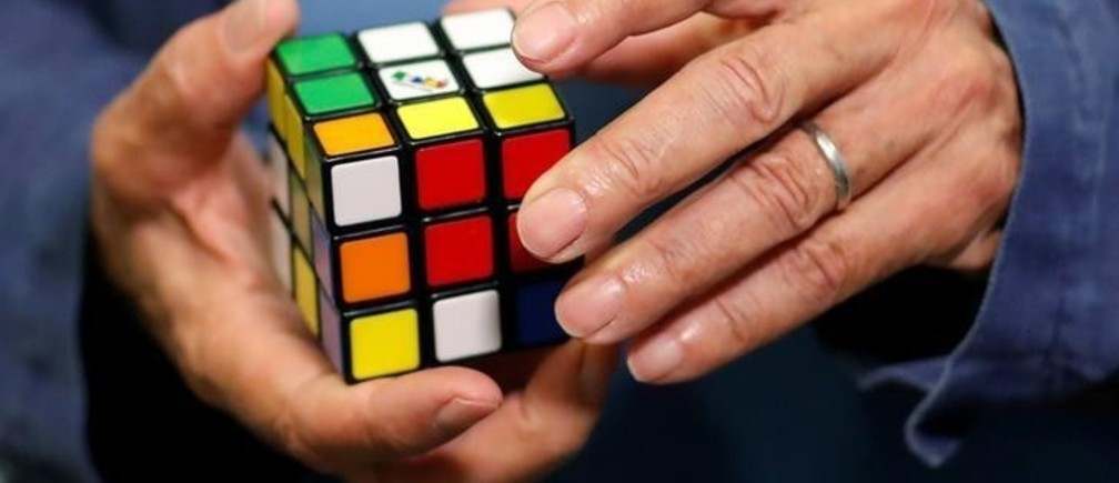 Erno Rubik, the creator of the puzzle, solves a Rubik's cube as he poses during the world's largest Rubik's Cube championship in Aubervilliers, near Paris, France, July 15, 2017. REUTERS/Stephane Mahe