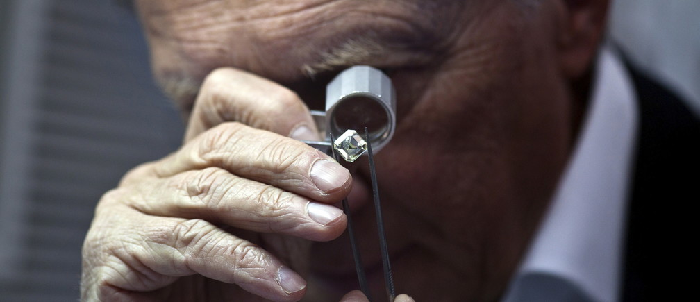 A trader inspects a gemstone at the Tel Aviv diamond exchange.