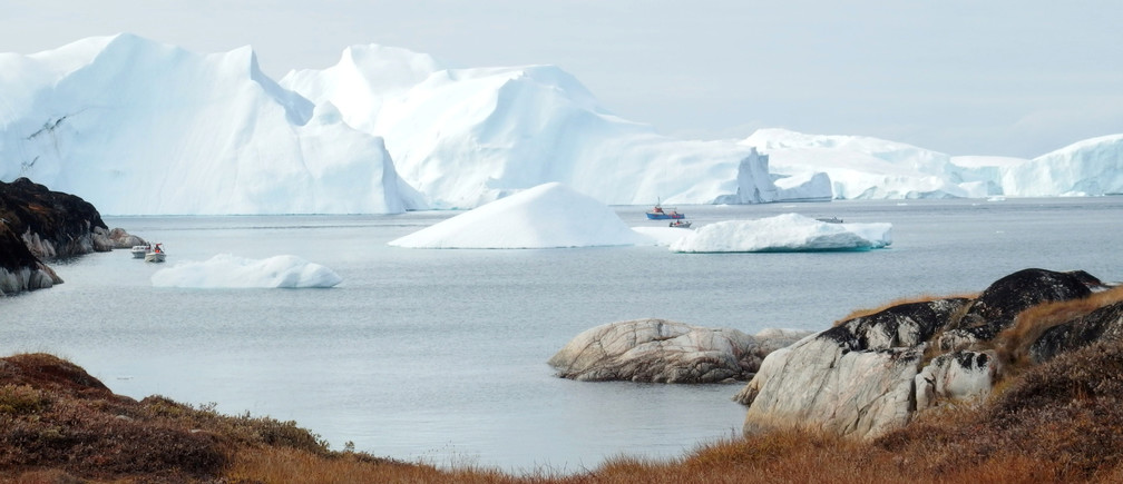 Fishing vessels are seen next to the icebergs near Ilulissat, Greenland September 13, 2017. Picture taken September 13, 2017. REUTERS/Jacob Gronholt-Pedersen - RC2ZCE9HQVL1