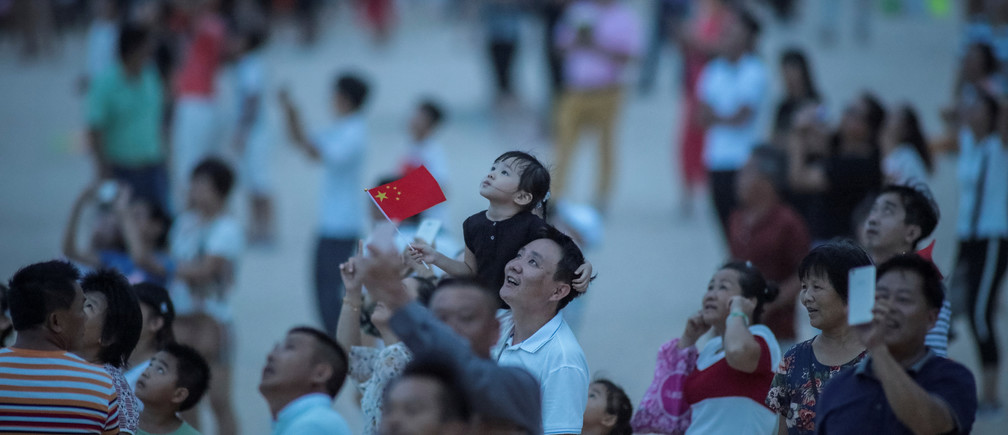 People watch the launch of the Long March-5 Y2 rocket from Wenchang Satellite Launch Center in Wenchang, Hainan Province, China July 2, 2017. REUTERS/Stringer ATTENTION EDITORS - THIS IMAGE WAS PROVIDED BY A THIRD PARTY. CHINA OUT. NO COMMERCIAL OR EDITORIAL SALES IN CHINA. - RC1872EAF580