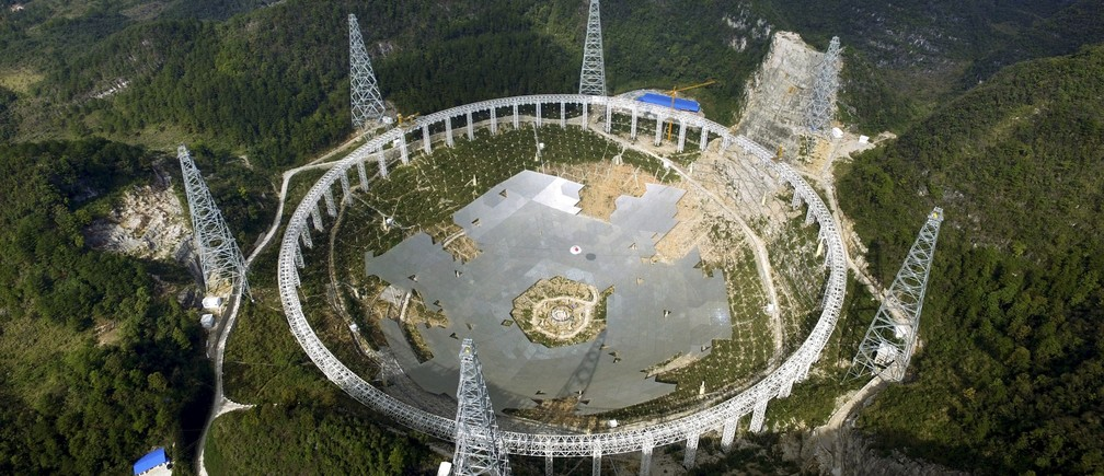 A 500-metre (1,640-ft.) aperture spherical telescope (FAST) is seen under construction among the mountains in Pingtang county, Guizhou province, China, November 26, 2015. The telescope, which will be the largest in the world, will be put in use by September 2016, according to local media. Picture taken November 26, 2015.