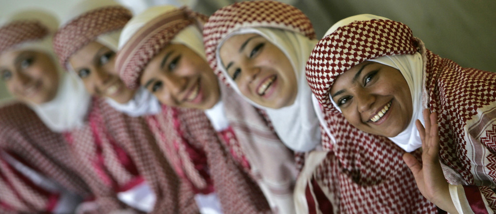 "Jordanian students in traditional costume take part in activities as part of the ""King Abdullah II Award for Physical Fitness"" project at Tlaa' Al-Ali High School sports complex in Amman October 22, 2008"