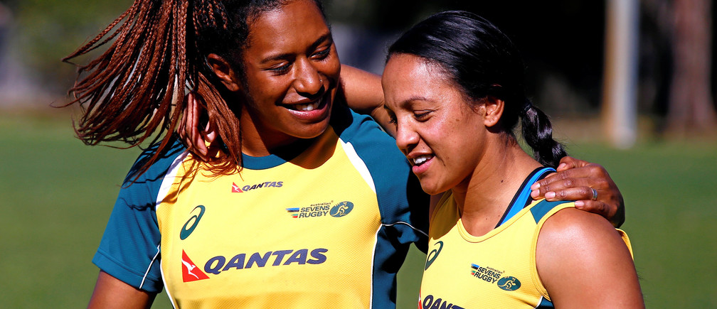 Members of the Australian Women's rugby sevens Olympic team Ellia Green (L) and Amy Turner embrace after a team training session in Sydney, Australia, July 22, 2016. Picture taken July 22, 2016.       REUTERS/David Gray  - S1BETSFOOZAB