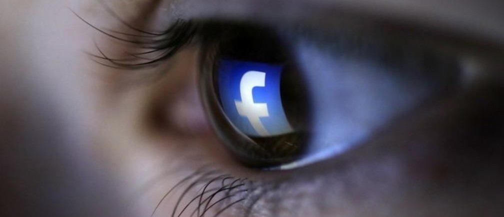 A picture illustration shows a Facebook logo reflected in a person's eye, in Zenica, March 13, 2015. Facebook Inc recorded a slight increase in government requests for account data in the second half of 2014, according to its Global Government Requests Report, which includes information about content removal.Requests for account data increased to 35,051 in the second half of 2014 from 34,946 in the first half, with requests from countries such as India rising and those from others including United States and Germany falling, the report by the world's largest Internet social network showed. Facebook said it restricted 9,707 pieces of content for violating local laws, 11 percent more than in the first half, with access restricted to 5,832 pieces in India and 3,624 in Turkey. Picture taken on March 13. REUTERS/Dado Ruvic (BOSNIA AND HERZEGOVINA - Tags: SOCIETY PORTRAIT SCIENCE TECHNOLOGY BUSINESS TELECOMS TPX IMAGES OF THE DAY) - GM1EB3H01I801
