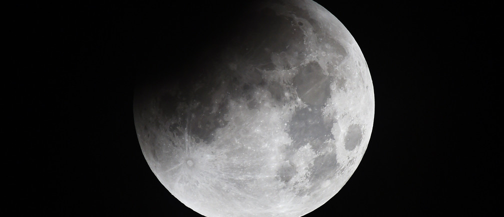 The moon goes into eclipse as seen from Rainham in Essex, September 28, 2015. The eclipse coincided with the moon being at it's closest point to earth on it's eliptical orbit.
