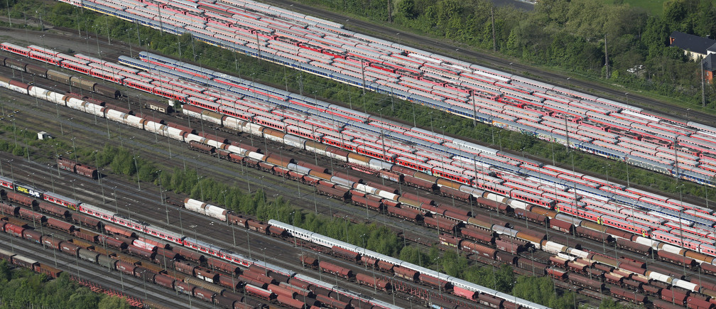 Train carriages, locomotives and freight trains of German railways Deutsche Bahn are parked at a storage facility in the North Rhine-Westphalian town of Hamm near Dortmund, Germany May 6, 2015. A record-setting seven-day strike by the GDL union of train drivers began on Monday, the eighth in a series of walkouts over pay and working conditions, threatening commuter chaos and disruption to vital supply chains.    REUTERS/Wolfgang Rattay - LR2EB560UG1CP