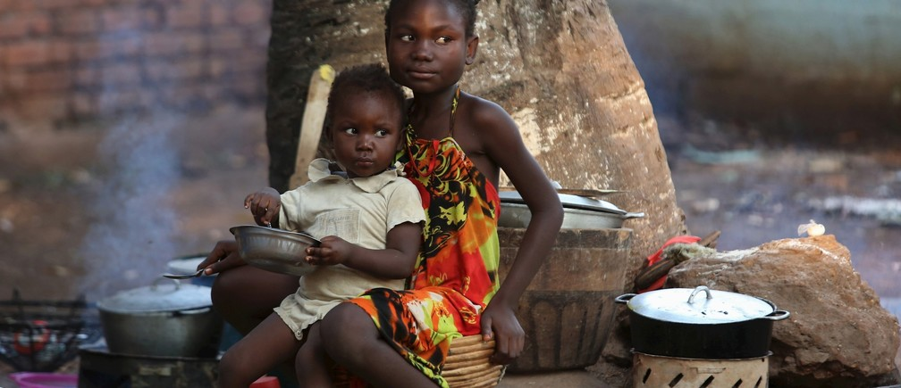 Children have their meal in a camp for internally displaced people on the grounds of the Saint Sauveur church in the capital Bangui, Central African Republic, November 25, 2015.