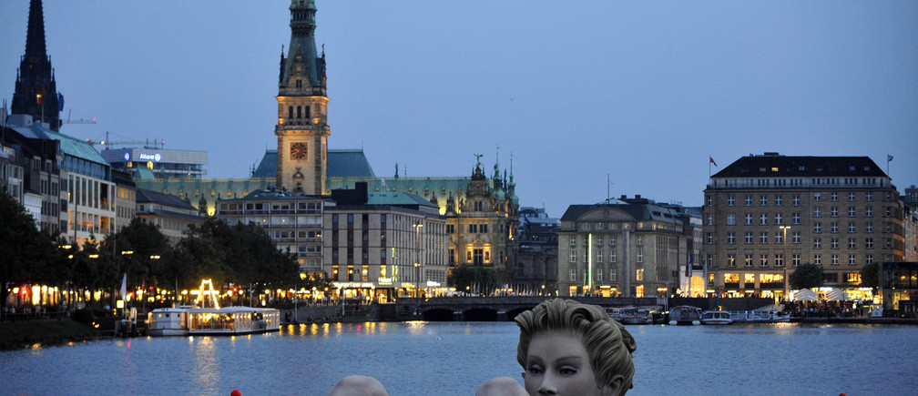 A 'mermaid' sculpture created by Oliver Voss is seen in the late evening hours on Alster lake in Hamburg August 3, 2011.