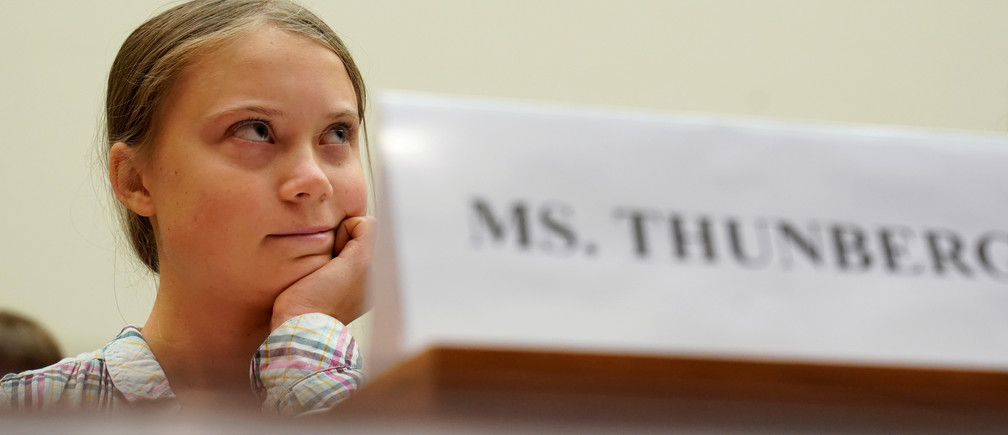 """Sixteen year-old Swedish climate activist Greta Thunberg testifies at a House Foreign Affairs subcommittee and House Select Climate Crisis Committee joint hearing on """"Voices Leading the Next Generation on the Global Climate Crisis"""" on Capitol Hill in Washington U.S., September 18, 2019. REUTERS/Kevin Lamarque     TPX IMAGES OF THE DAY - RC195B0340D0"""