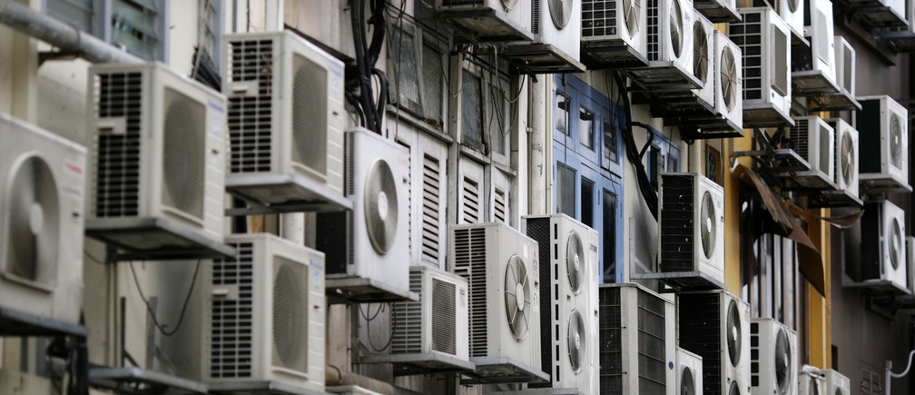 Air conditioners on the walls of a building in Singapore's financial district
