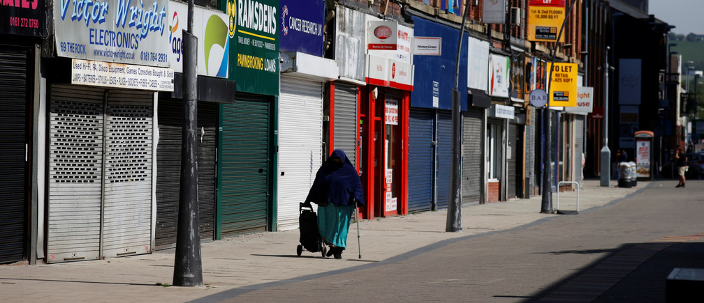 A person walks past closed shops in Bury, following the outbreak of the coronavirus disease (COVID-19), Bury, Britain, May 7, 2020. REUTERS/Phil Noble - RC2NJG94BMU5