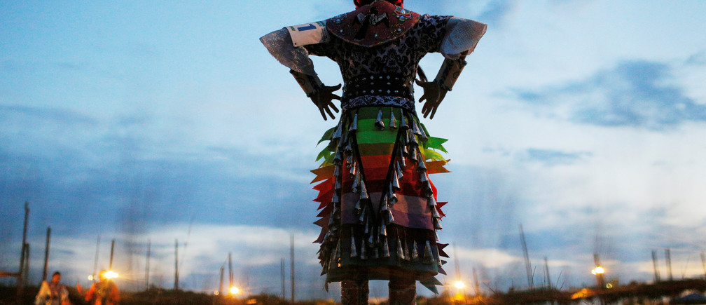 Nine-year-old Anhinga Benally, who is a Navajo junior girls' jingle competitor, prepares to dance on the first night of the 32nd Annual Taos Pueblo Pow Wow, a Native American dance competition and social gathering, in Taos, New Mexico, U.S., July 7, 2017.  Picture taken July 7, 2017.   REUTERS/Brian Snyder     TPX IMAGES OF THE DAY - RC1CC2DEE170