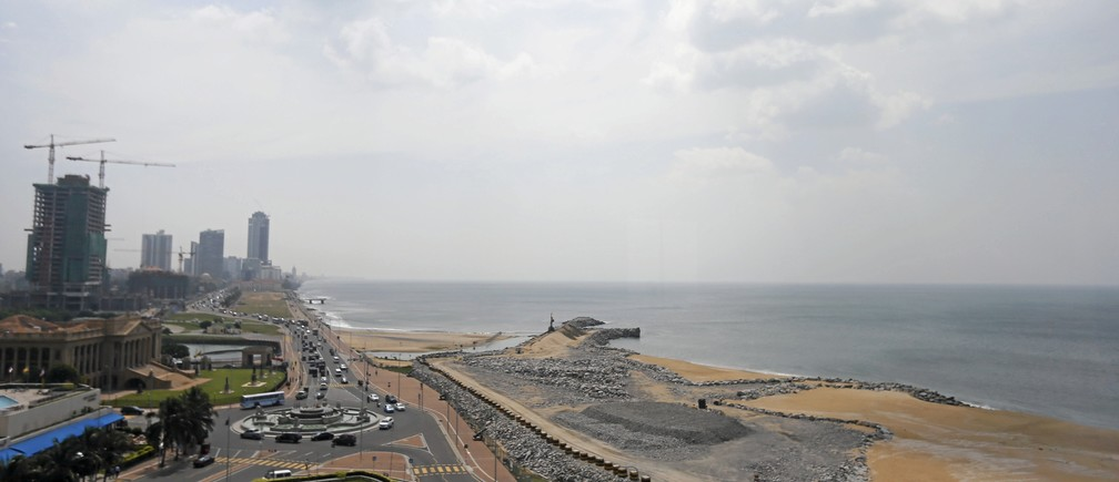 """A general view of the """"Colombo Port City"""" construction site (R), backed by Chinese investment, is seen in Colombo, Sri Lanka January 14, 2016. Sri Lanka is to go ahead with a $1.4 billion Chinese-backed real estate project after some changes to its terms, a minister said on Tuesday, signalling readiness to accept more Chinese investment in the face of a balance-of-payment crisis."""