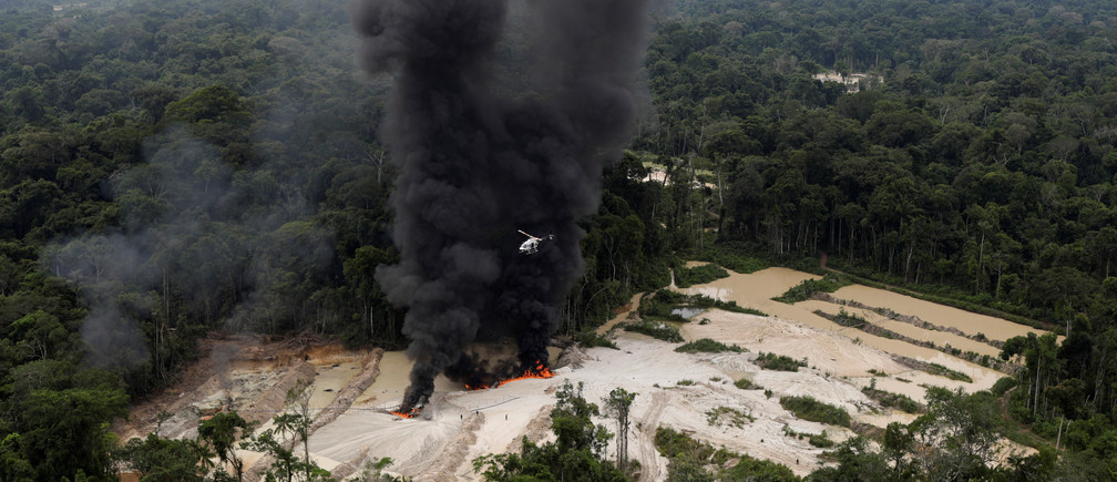 "Machines are destroyed at an illegal gold mine during an operation conducted by agents of the Brazilian Institute for the Environment and Renewable Natural Resources, or Ibama, in national parks near Novo Progresso, southeast of Para state, Brazil, November 5, 2018. REUTERS/Ricardo Moraes   SEARCH ""IBAMA MORAES"" FOR THIS STORY. SEARCH ""WIDER IMAGE"" FOR ALL STORIES. TPX IMAGES OF THE DAY. - RC1ECE51CB90"