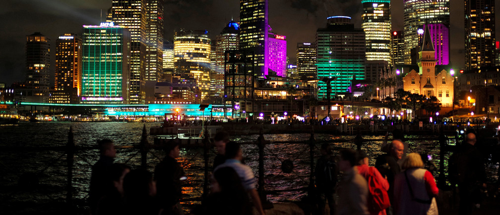 Office building are lit with colorful projections of light on the first night of the Sydney Vivid Festival light and sound show in Sydney, Australia May 26, 2017. REUTERS/Jason Reed - RC138B916330