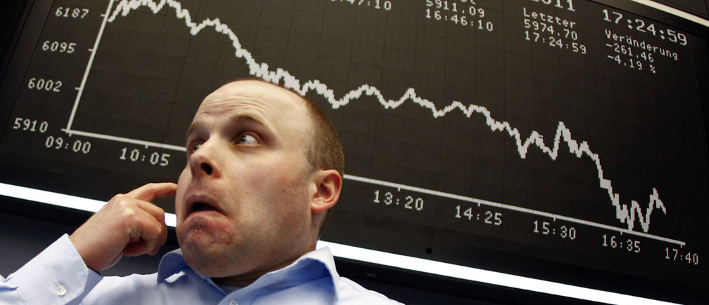 A trader reacts in front of the DAX index board at Frankfurt's stock exchange August 8, 2011. Germany's DAX fell 4.5 percent to below 6,000-mark for the first time since September 2010.  REUTERS/Kai Pfaffenbach (GERMANY - Tags: BUSINESS IMAGES OF THE DAY) - GM1E7890GO201