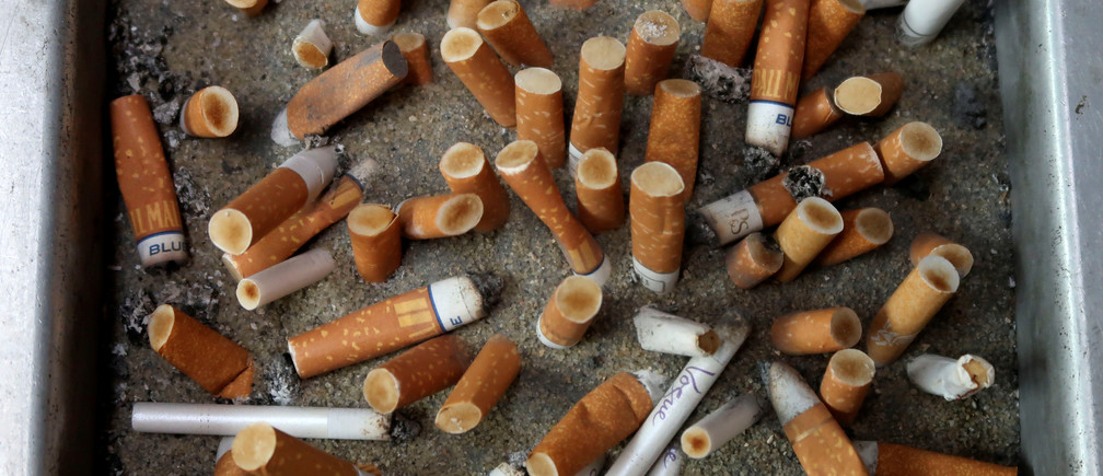 Discarded cigarette butts are pictured at the German Social Democratic Party (SPD) headquarters in Berlin, Germany, May 26, 2019.       REUTERS/Fabrizio Bensch - RC178CA76740